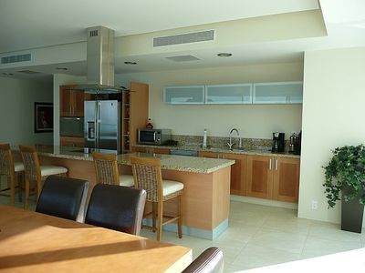Granite kitchen and great room overlooking the ocean