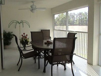 Oversized Lanai with granite tables and six chairs, two are rockers with ottoman