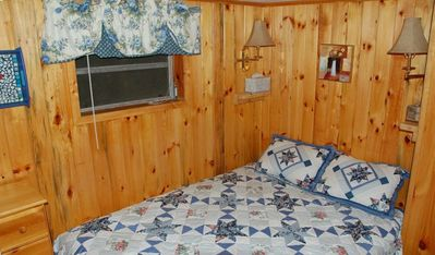 Country comfort in our knotty pine paneled bedrooms.