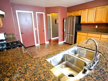 Full Kitchen with Granite counters and Stainless Steel appliances.