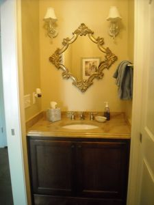 Single vanity in half bath portion of Master Bathroom.