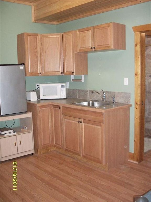 Cottage kitchenette fully stocked including toaster oven, mirowave and frig.