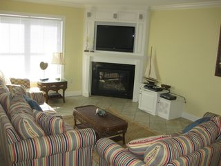 Belmont Towers Ocean City townhome photo - Living area w/ fireplace, surround sound TV and queen sleeper sofas if needed