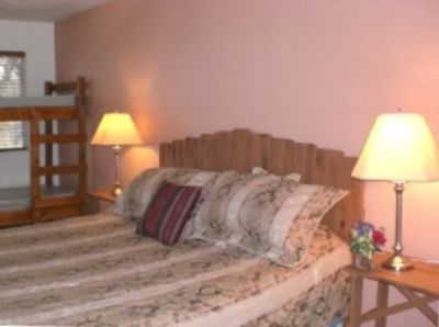 Bedroom #4: Sleeps 6,  King size bed, 4 twin beds (bunk beds)