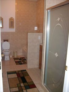 First floor bathroom with bath tub & stand up shower.