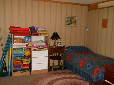 Twin bed in walk-out basement (games, puzzles, paddles & vests)