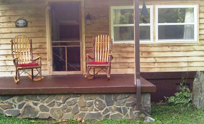 Front of house with Amish-made hickory rocking chairs.