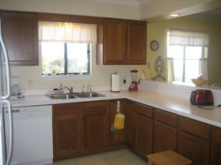 Surfside Beach condo photo - Ocean views from both kitchen and dining room