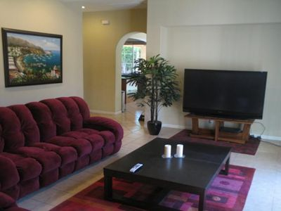 OUR COZY 2ND FAMILY ROOM WITH 66' HD FLAT SCREEN & 6 RECLINERS AS WELL...