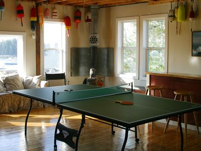 Gameroom has bar, ping pong and large picture window with abundant ocean views