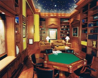 Exquisite European Library with card table, aquarium, and couches to lounge on