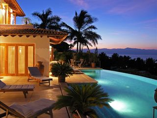 Punta del Burro house photo - Sunrise View to the East toward Puerto Vallarta - Lap pool in the foreground.