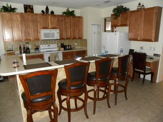 Bellavida Resort house photo - Kitchen breakfast bar with Corian Couter tops and Ice Maker