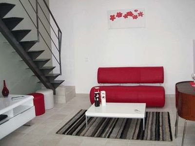 Promenade des Anglais apartment rental - Open plan living area with stairs to upper level