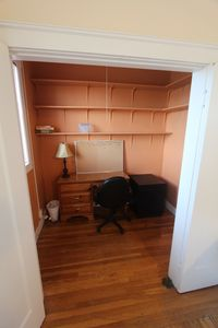 The alcove can be set up as an office with desk or as a sleeping area with futon
