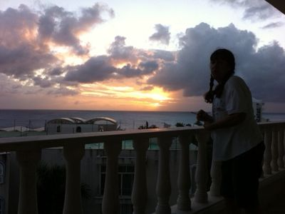 Preparing to watch yet another beautiful sunset from our balcony.