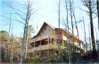 Spacious 3 bedroom/2 bath log home + sitting area and two wrap around decks.