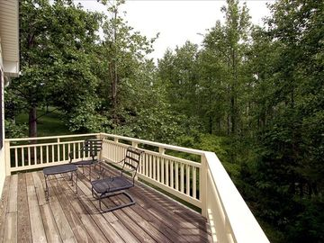 Spacious open deck to enjoy wooded view