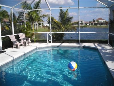 Cape Coral house rental - View from the front door and living room of the heated pool and lake.