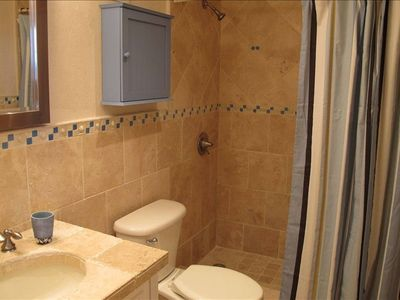 New Renovated Guest Bath with Natural Stone throughout.