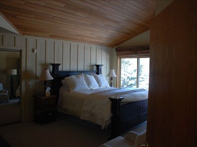 Roomy master bedroom on ground floor with view of lake. Slider opens to deck.