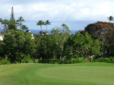 Ocean view from large upstairs lanai, across second green of Makai golf course.