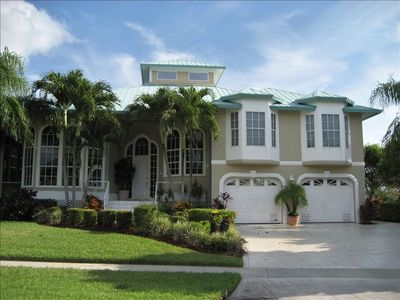 Beautifully landscaped residence located in walking distance of beach & shopping