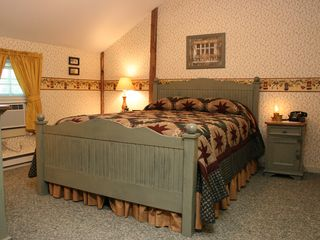 Winchester house photo - A cozy country bedroom