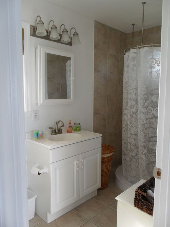 Full size bathroom showing the free standing circular shower.