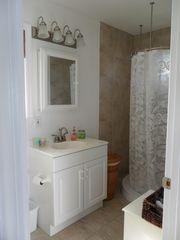 Staniel Cay cottage photo - Full size bathroom showing the free standing circular shower.