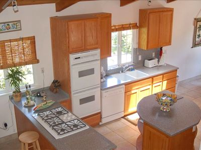 kitchen has: 5 burner gas cooktop,  double ovens, corian counter tops, skylight