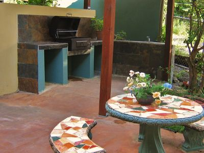 BBQ area (Kiosko style) with sink and outdoor table.