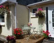 Holiday cottage in quiet location with parking, patio garden Wifi Food hamper