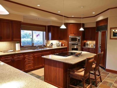 Fully-equipped, modern kitchen with island and breakfast bar