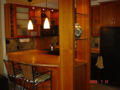 Modern/open kitchen with upgraded appliances and cherrywood cabinets