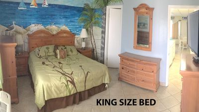 Bedroom with King size bed and 3 dressers