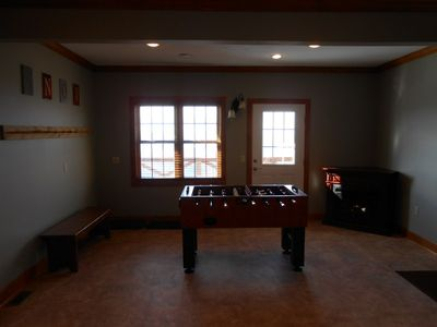Foosball table, fireplace, ski storage