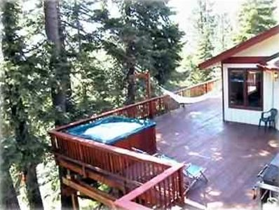 Private hot tub opens to billiard room and National Forest in back yard.