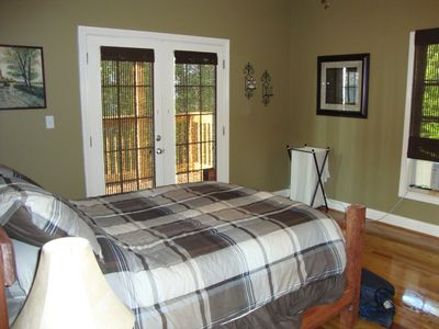 Master bedroom with french doors to the deck