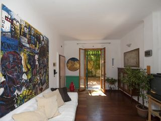 Bologna apartment photo - The living room, giving to the garden.