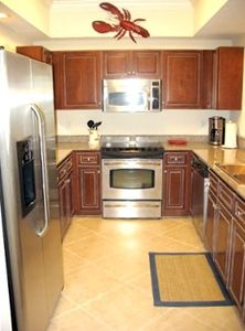 Enjoy! Gorgeous dark wood cabinets w/ granite countertops,fully-equipped kitchen