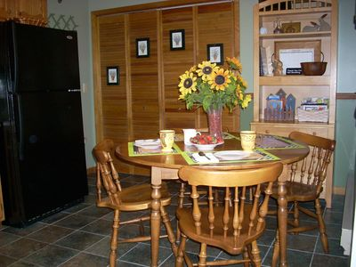 The country kitchen table invites you to sit and visit for a while.