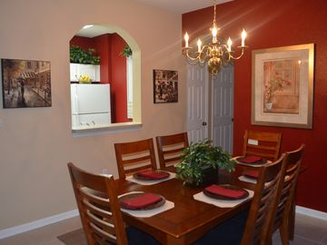 Dining area with kitchen pass through. Room for high chair near table.