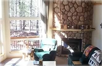 The Greatroom with large stone fireplace.