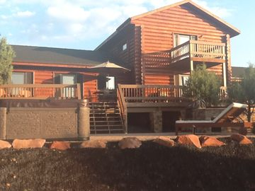 Show Low cabin rental - Back of Log Home with outdoor deck, patio,spa and built in Fire Magic BBQ
