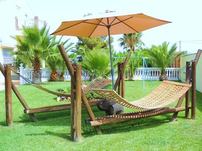 2 Custom Made Swinging Hammocks with Parasol on Lawn, Besides the Heated Pool