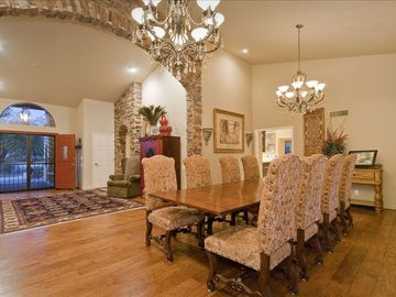 Formal Dining Room seats 10 with Beautiful Wood Floors and Chandeliers