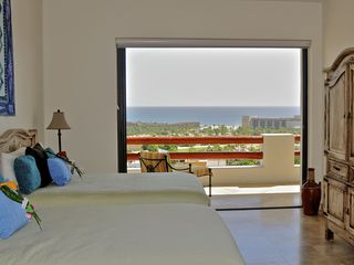 San Jose del Cabo condo photo - This bedroom has two double beds and an adjoining double-vanity bathroom.