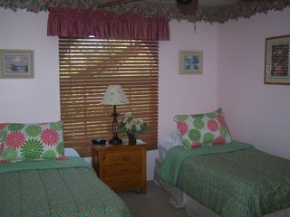 Bedroom 2 of 3 on first floor has a set of twin beds. - Fort Myers Beach house vacation rental photo