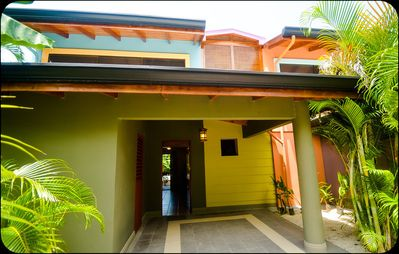 Nosara townhome rental - main entry, car port, washer dryer room